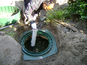 Installing a septic filter in the outgoing baffle to prevent debris from reaching the drainfield