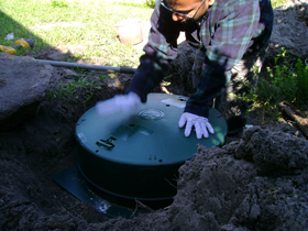 Installing a riser on the septic tank for easy access to clean filter and for pumping